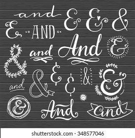 Hand lettering calligraphic catchwords and ampersands on a blackboard