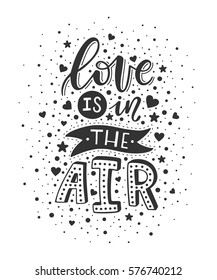 "Hand lettering ""Love is in the air"". Vector illustration. Valentine's day"