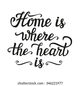 Hand lettering typography poster. Calligraphic script 'Home is where the heart is' isolated on white.For posters, cards, home decorations, t shirt, wooden signs, housewarming.Romantic vector quote.