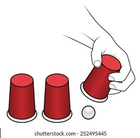 A hand lifting a cup of a cups-and-ball game.