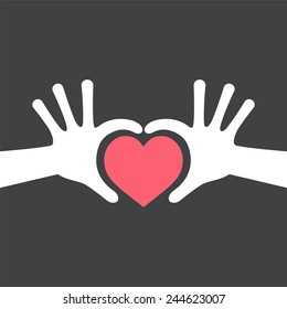 Hand Making Love Heart Sign on Black Background -