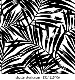 Hand painted black vector palm leaves seamless pattern on white background. Perfect for fabric, wallpaper or wrapping paper.