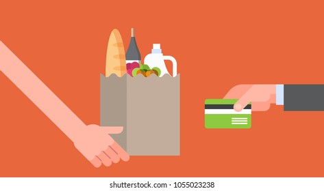 Hand Paying For Paper Bag Full Of Grocery Products With Credit Card, Online Food Order And Delivery Service Concept