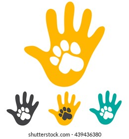 Hand and pet dog paw.
