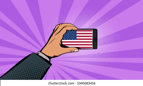 Hand with phone. Flag of the United States of America on the phone screen