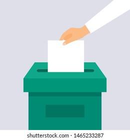 Hand puts voting ballot in ballot box. Election concept.
