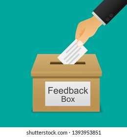 Hand putting paper in the feedback box.