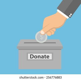Hand putting silver coin in the donation box