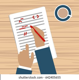 Hand with red pen proofreading a story