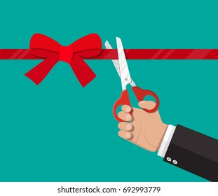 Hand with scissors cut red ribbon with bow. Opening ceremony, celebration, surprises. Vector illustration in flat style