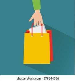 Hand with shopping bag. Flat design.Vector Illustration.
