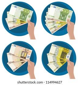 Hand showing five  50, 100 y 200 euro bills