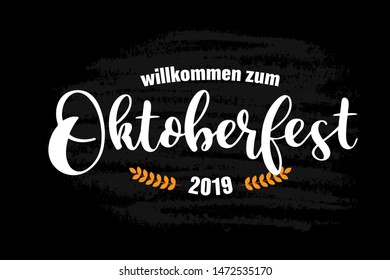 Hand sketched Welcome to Oktoberfest 2019 quote in German, Willkommen zum Oktoberfest 2019,  isolated on black background. Drawn lettering typography for poster, postcard, banner.