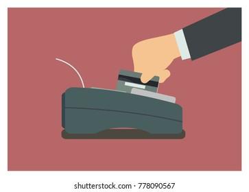 Hand swiping credit card on the EDC machine