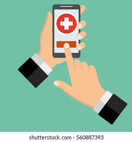 hand with telephone and medicine on a green background