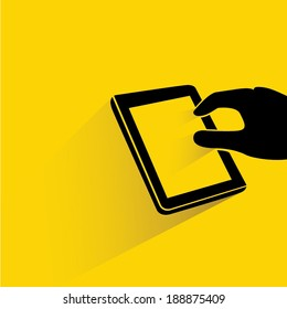 hand touching tablet on yellow background, flat and shadow style