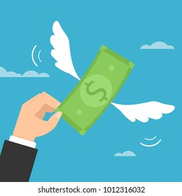 Hand trying to catch flying dollar money.
