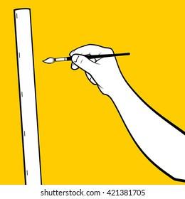 Hand using paint brush