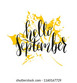 Hand written lettering message hello september.  Autumn welcome quote on color leaf stamp background. Modern lettering. Hello September design for cards, banners, posters.