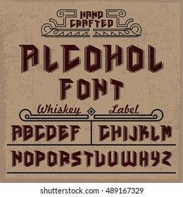 Handcrafted Alcohol font with whiskey label and decorations, dusty background