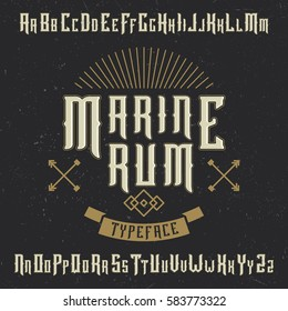 Handcrafted 'Marine' typeface with arrows and a ribbon. Label font. Vintage font,