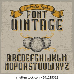 Handcrafted 'Vintage' font with barrels and a ribbon. Dusty background.