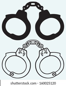 Handcuffs silhouettes isolated on blue background