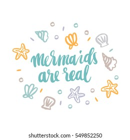 """Hand-drawn card with inscription """"Mermaids are real""""; with seashells, starfish and pearls, in a trendy calligraphic style."""