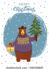 Hand-drawn cartoon bear wearing a sweater and a hat with a gift and a Christmas tree in his paws. Merry Christmas greeting card design. Vector illustration.