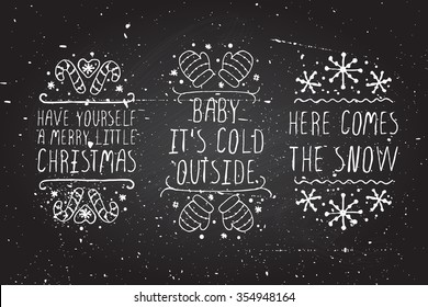 Handdrawn christmas badges with text on blackboard background. Have yourself a merry little Christmas. Baby its cold outside.  Here comes the snow.