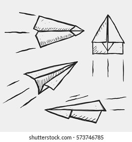 Hand-drawn isolated paper planes. Sketch on tnotebook.