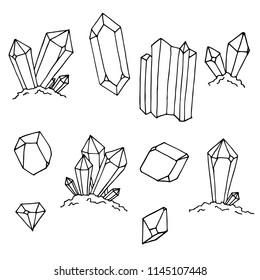 Hand-drawn set of crystals. Isolated objects on a white background. Vector sketches. Cartoon doodles.