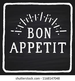 "Hand-drawn text on a blackboard ""bon appetite"""