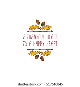 Handdrawn thanksgiving label with acorns and text on white background. A thankful heart is a happy heart.