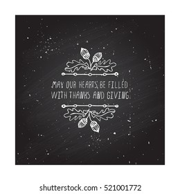 Handdrawn thanksgiving label with acorns and text on chalkboard background. May your hearts be filled.