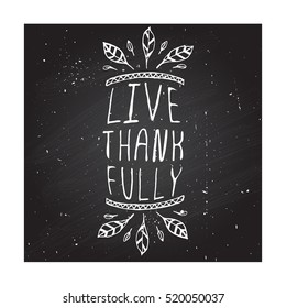 Handdrawn thanksgiving label with feathers and text on chalkboard background. Live thankfully.