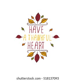 Handdrawn thanksgiving label with leaves and text on white background. Have a thankful heart.