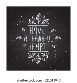 Handdrawn thanksgiving label with leaves and text on chalkboard background. Have a thankful heart.