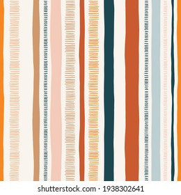 Hand-drawn whimsical textured organic vertical lines and stripes vector seamless pattern. Doodle folk abstract geometric print in bright colors. Marks, scribbles. Perfect for home decor