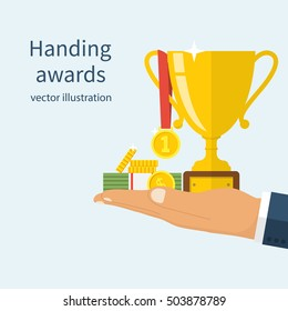Handing awards concept. Man holding a reward for awarding. Recognition, bonus, gift. Cup, medal, money on hand. Vector illustration flat design.