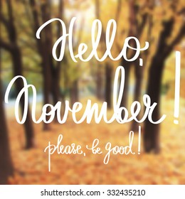 Handmade calligraphy and text Hello november.  Poster with blurry effect. Vector blurred photographic background
