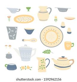 Handmade home cookware set:  plates, cups, jugs, teapots. Beige blue tones, simple handmade patterns