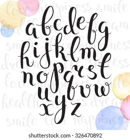 Handmade letters. Handwritten alphabet with watercolor spots on background. Hand drawn calligraphy. Modern inc typography.