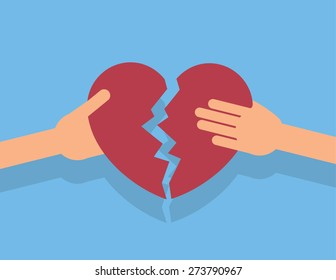 Hands breaking apart a large heart