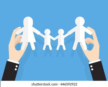 hands of businessman or manager holding family cut out paper