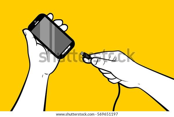 スマートフォンのバッテリを手で充電中