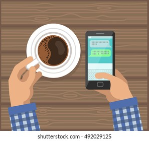 Hands with Cup Of Coffee and Phone