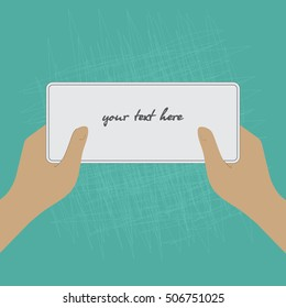 hands hold a white sheet template. green scratched background