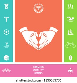 Hands holding baby - protection symbol. Heart shape made with hands