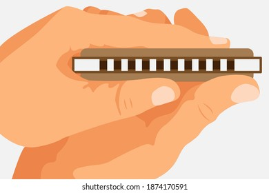 Hands holding a brown harmonica